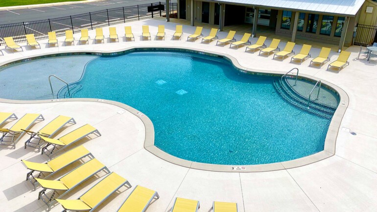 Our beautiful pool has a large max capacity plenty of lounge chairs.